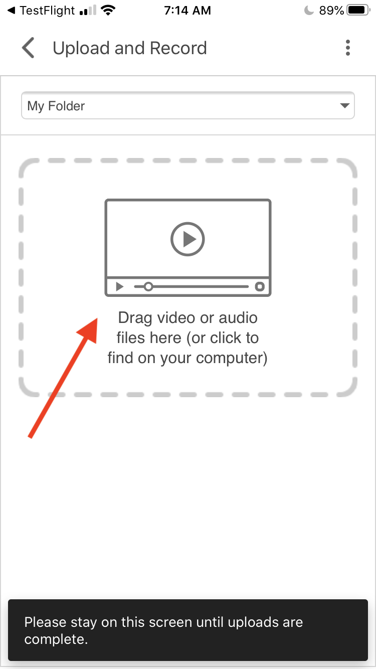 A screenshot of the upload screen in the iOS Panopto app. The screen says 'Drag video or audio files here (or click to find on your computer)' and warns the user to 'stay on this screen until uploads are complete'.